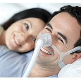 man with cpap mask smiling